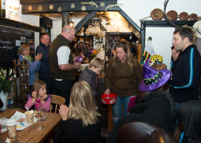 Giving out prizes in a packed pub